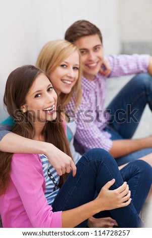 Friends sitting together - stock photo