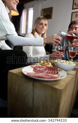 Friends socializing - stock photo