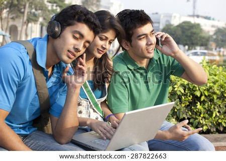 Friends spending time in campus - stock photo