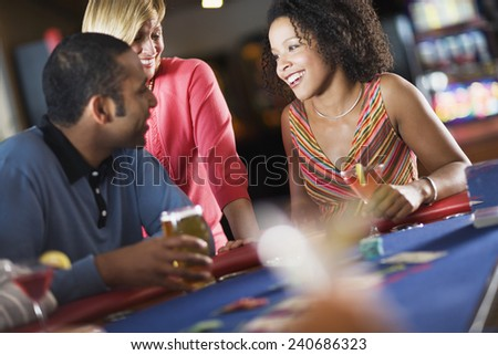 Friends Talking at Game Table - stock photo