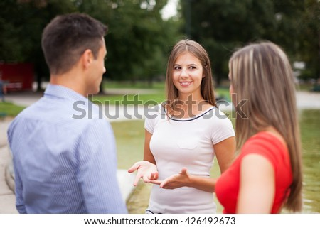 Friends talking to each other - stock photo