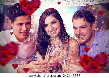 Friends toasting with champagne against hearts - stock photo