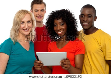 Friends watching video on tablet pc and having great time - stock photo