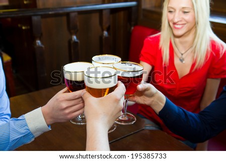 Friends with beer  in a pub  - stock photo