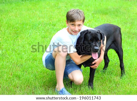friendship boy dog labrador summer green grass - stock photo