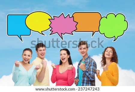 friendship, communication and people concept - group of smiling teenagers showing triumph gesture over blue sky and cloud background with text bubbles - stock photo
