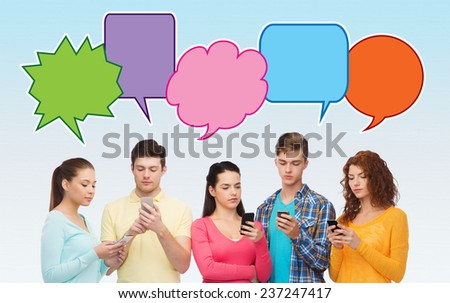 friendship, communication, technology and people concept - smiling friends showing blank smartphones screens over blue background with doodles - stock photo