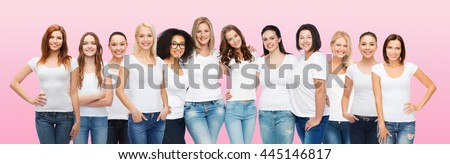 friendship, diversity, body positive and people concept - group of happy women of different age size and ethnicity in white t-shirts hugging over pink background - stock photo