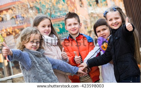Friendship forever - outdoor portrait of happy junior school kids  together