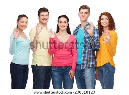 friendship, youth and people concept - group of smiling teenagers showing ok sign - stock photo