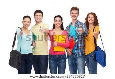 friendship, youth, education and people concept - group of smiling teenagers with folders and school bags showing thumbs up - stock photo