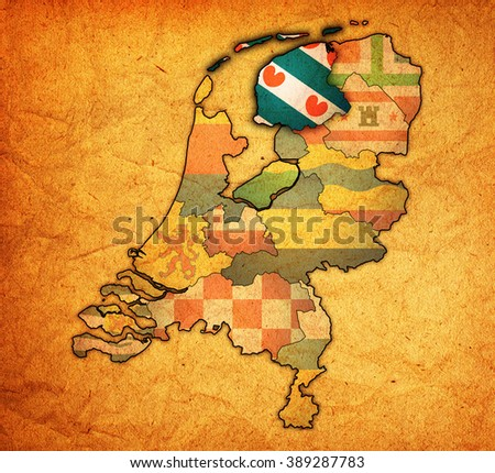 friesland flag on map with borders of provinces in netherlands - stock photo