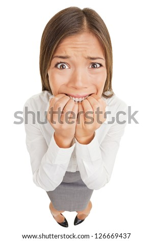Frightened and stressed young business woman biting her fingers, high angle - stock photo
