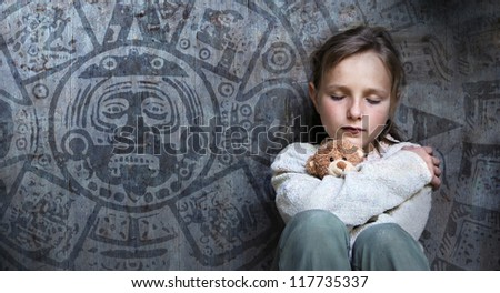 Frightened child with date of end of the world. - stock photo