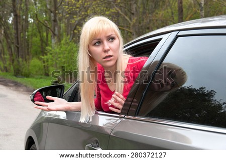 frightened girl in the car - stock photo