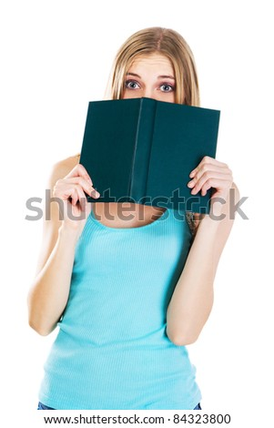 Frightened girl with a book, white background - stock photo