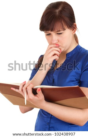 frightened young woman reading book, white background - stock photo