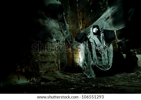 Frightening death in an abandoned house. Halloween, horror. - stock photo