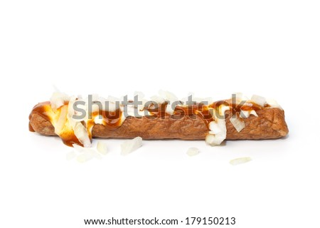 Frikandel speciaal, a Dutch fast food snack, with mayonnaise, curry sauce and chopped onions - stock photo
