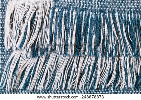 Fringe of a blue and white scarf - stock photo