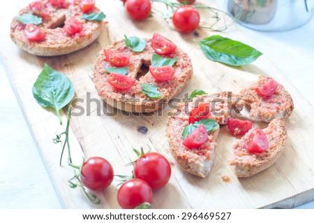 Friselle , typical Italian bruschetta with corn , tomato and basil - stock photo