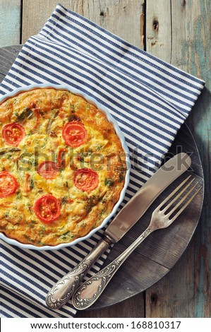 Frittata with Fresh Vegetables and chicken meat in baking mold - stock photo