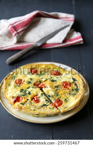 Frittata with spinach and tomatoes - stock photo