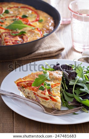 Frittata with tomatoes, red peppers, mustard and ham - stock photo