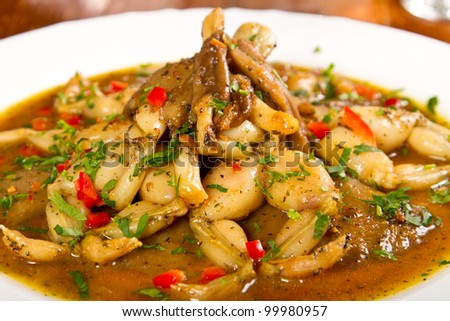 Frog legs stew with parsley - stock photo