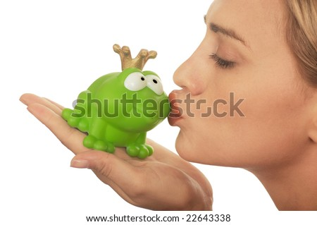 Frog price being kissed by a beautiful glamour model isolated on white - stock photo