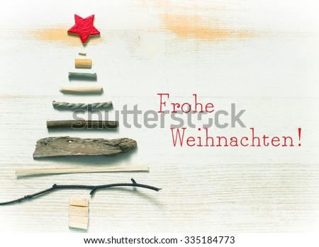 Frohe Weihnachten - Merry Christmas in german - stock photo