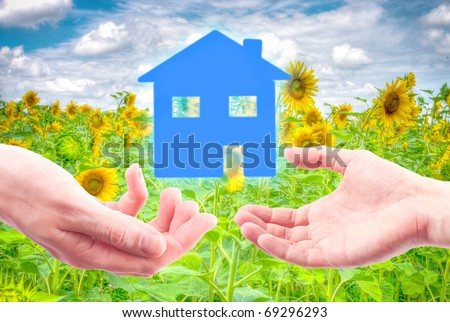 From hand to hand the house as a symbol of real estate business. - stock photo