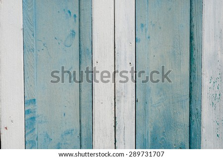 From the window, put out planks recycling painted blue and white. - stock photo