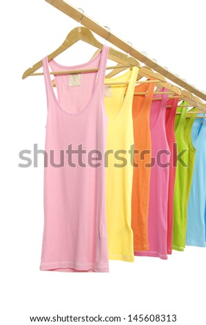 From view rainbow many peignoir hanging on wooden hangers - stock photo