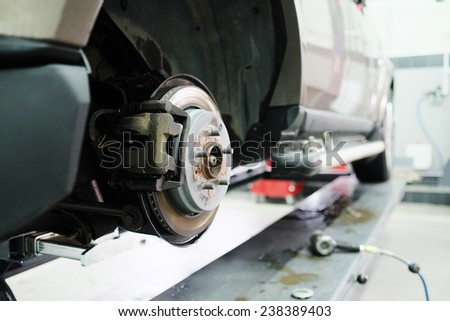 Front Disk brake assembly on a modern car. Brake job in progress - stock photo