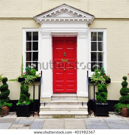 Front Door of a Beautiful Old English Town House - stock photo