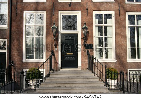 Front door of a classic office building - stock photo
