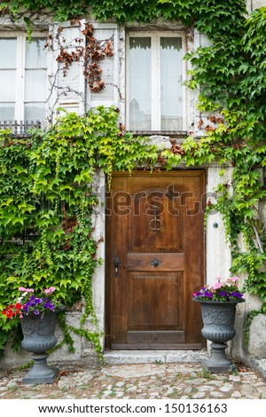 Front Door of an Old Switzerland Cottage House - stock photo