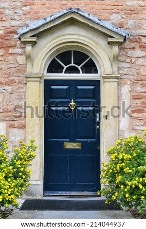 Front Door of Beautiful Old English Town House - stock photo