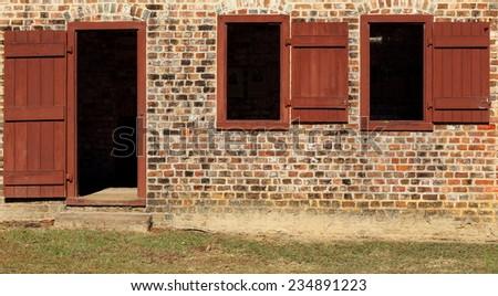 front door of old brick slave quarters - stock photo
