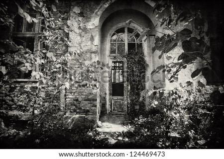 front door of spooky vintage building- textured background - stock photo