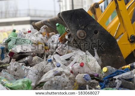 front-end loader picking up trash - stock photo