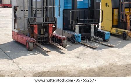 front forklift loader pallet stacker truck equipment - stock photo