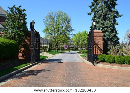 Front Gate to a Private, Exclusive Suburban Neighborhood - stock photo