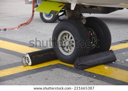 Front landing gear on the ground - stock photo