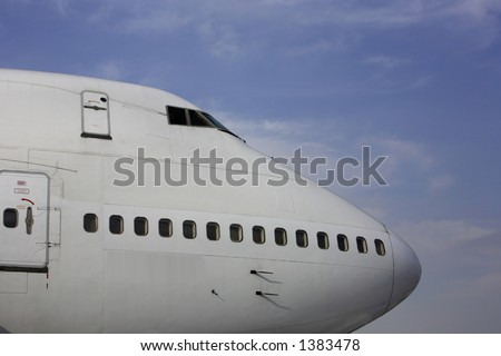 Front of a large passenger airliner. - stock photo
