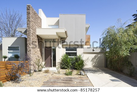 Front of a two storey contemporary architect designed townhouse home - stock photo