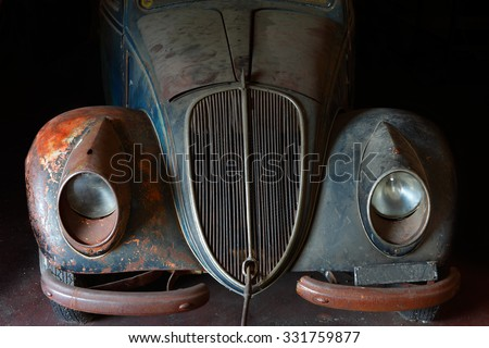 Front of abandoned old vintage car - stock photo