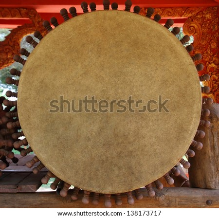 front of big drum for Buddhist Cult in temple of north Thailand - stock photo
