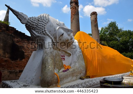 front of big reclining Buddha in Ayutthaya, central of Thailand, blue sky, blue sky cloud - stock photo